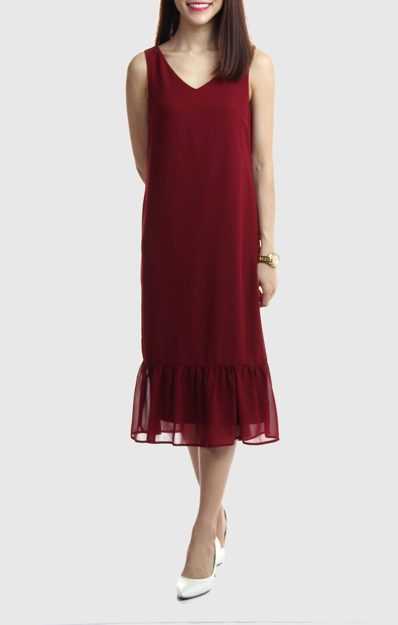 99db1c0418c ... A classy dress in burgundy featuring a V-neckline and ruffled hem ...