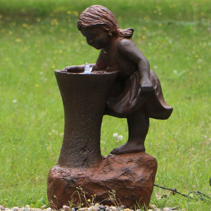 Girl At Water Fountain