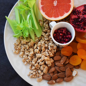 colorful plate of Entis insect food snacks, fruit and vegetables
