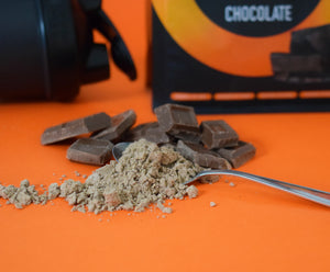 Cricket protein powder on a spoon and chocolate