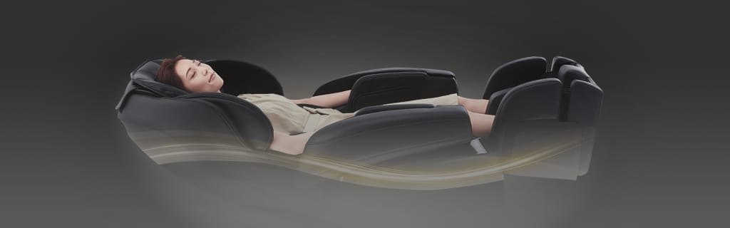 a person lying on top of a car