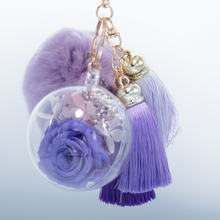 Load image into Gallery viewer, Purple Preserved Rose | Purple Fluffy Ball with Faded Purple Thread Tassels Keychain