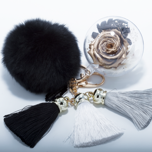 Gold Preserved Rose | Black Fluffy Ball with Faded Black thread Tassels Keychain - The Only Roses