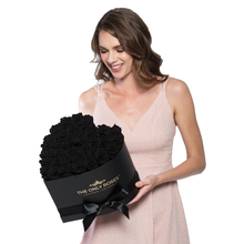 Load image into Gallery viewer, Black with One Gold Preserved Roses | Heart Black Huggy Rose Box - The Only Roses