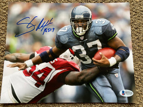 "Shaun Alexander Signed Seattle Seahawks 8x10 ""Stiff Arm"" Photo"