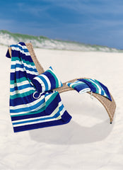 Blue stripe towel and pillow bag placed on a deckchair on a beach