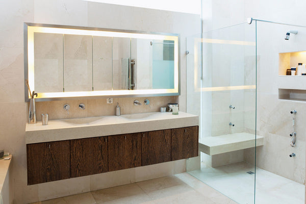 Large mirror cabinet in bathroom with walk in shower