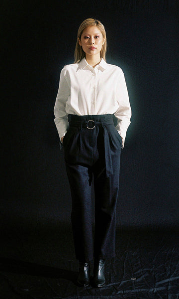 High-waisted buckled navy trousers