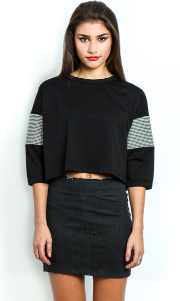 Black cropped top with gingham sleeves