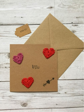 MY BAKER's Valentine's Day Gift Giveaway includes a cute brown paper card with red crochet love hearts floating on top