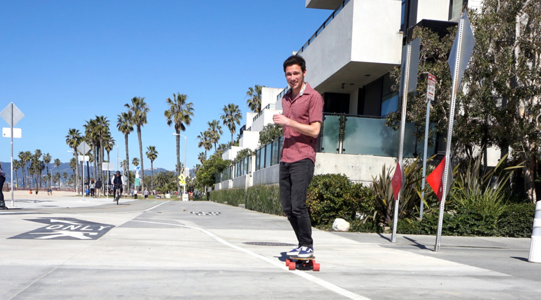 Guy Riding Eggboard in Venice Beach Boardwalk California