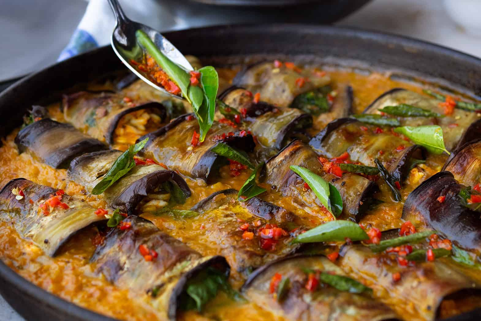 Stuffed Aubergine In Curry And Coconut Dal
