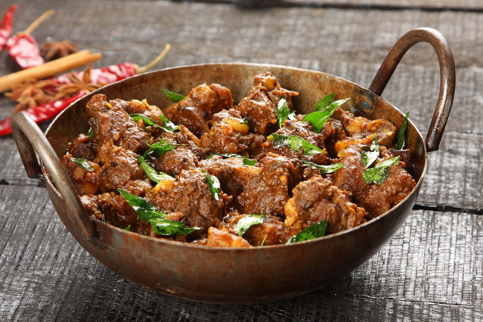 What are the best spices to use in a spicy lamb curry?