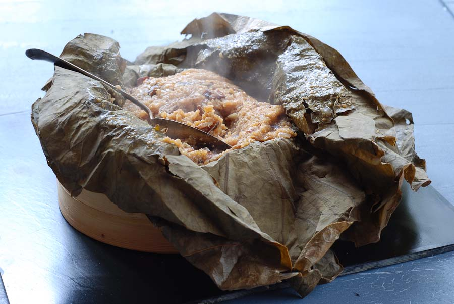 Steamed glutinous rice in a lotus leaf