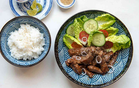 Blue bowls with jasmine rice and beef in