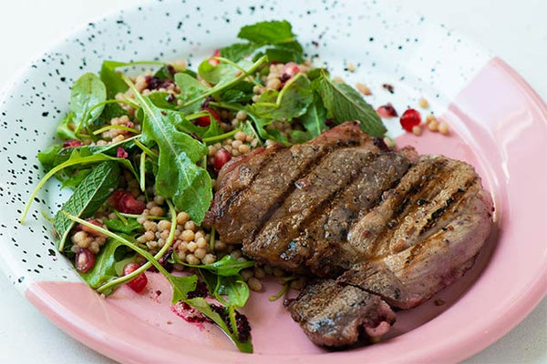Chargrilled Hibiscus-Marinated Lamb With Rocket, Mint, Giant Couscous and Pomegranate Salad
