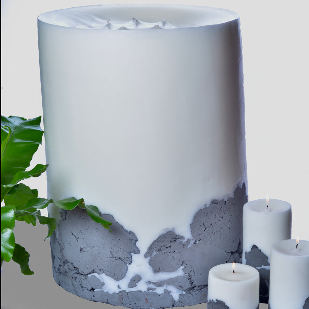 The BFG by Africandle. 400mm by 600mm, multi wick pillar candle set in a concrete base.