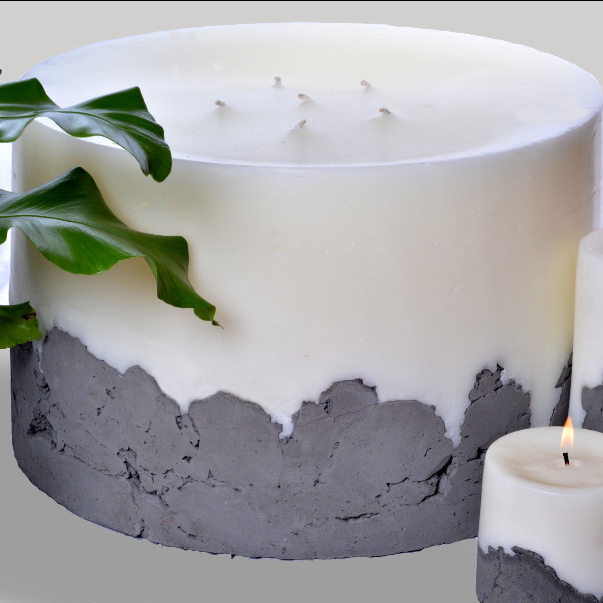 The Beast by Africandle. 400mm by 300mm, multi wick pillar candle set in a concrete base.