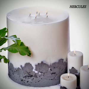 The Hercules by Africandle. 400mm by 450mm, multi wick pillar candle set in a concrete base.