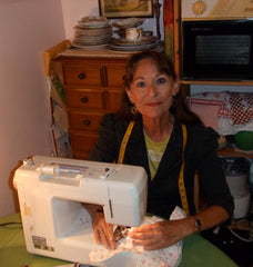 Mama Kitty sewing in her kitchen.