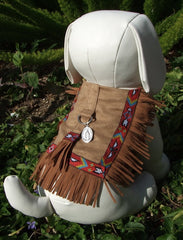 Dog jacket of fringed suedecloth.