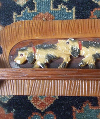 Wood carved dogs towel bar.