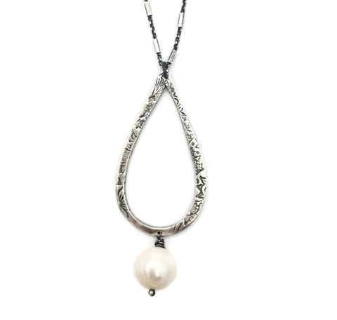 Teardrop necklace on designer chain