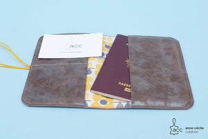 Passport card holder in gray leather