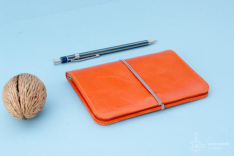 orange leather passport wallet