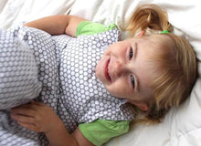 Load image into Gallery viewer, Smiling, happy toddler with pigtails