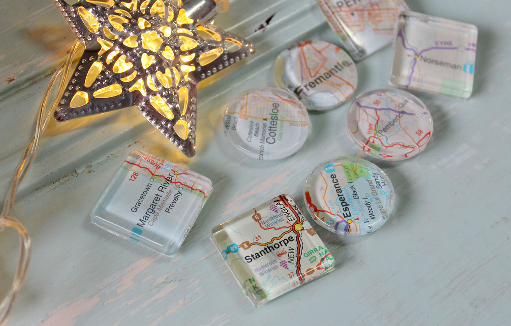 Magnets made using little snippets from maps. A cute, compact and useful travel memento. Crafternoons at Bridget Bunchy Recycled Gallery in The Summit