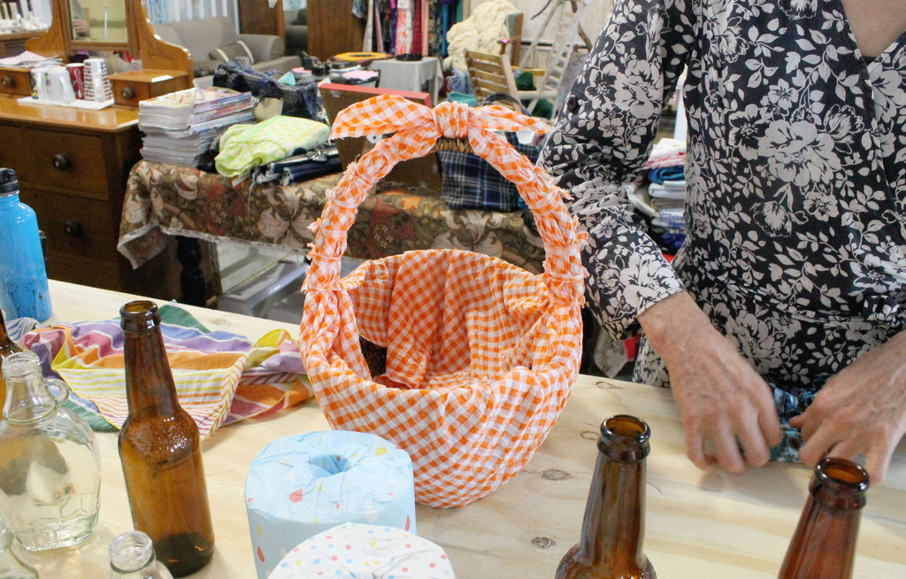 Furoshiki gift wrapping crafternoon workshop. Basket tied up with cloth.