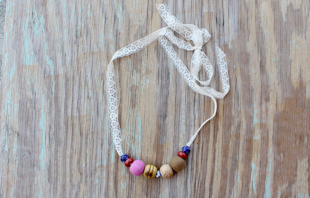 Wooden macarame bead necklace made from recycled materials