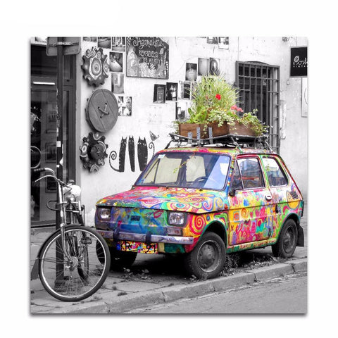 Image of Colorful Vintage Car on Black  And White StreetScape