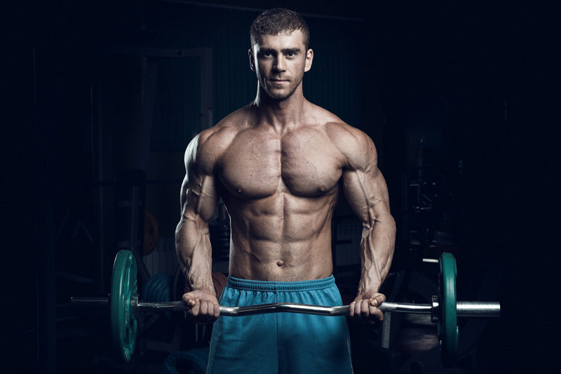 A bodybuilder bicep curling to show the best fat burner