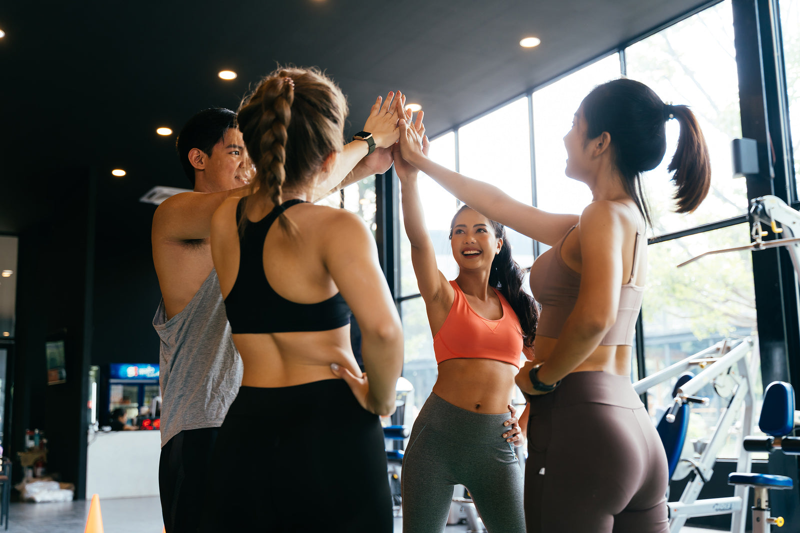 3 women and 1 man in the gym during a workout