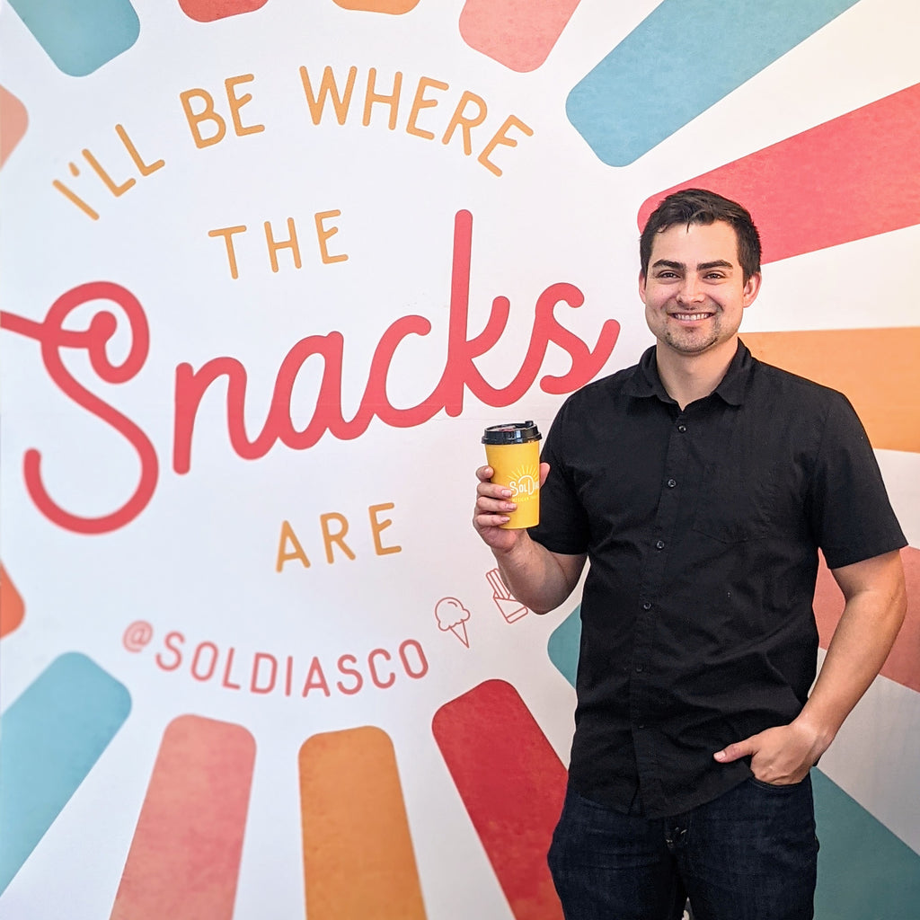 Image of Victor, our owner holding Sol Dias Atole.