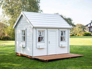 Kids Playhouse Arctic Nario with wooden terrace in garden |white outdoor playhouse by WholeWoodPlayhouses