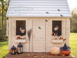 Natural Wonder Kids Playhouse Decorated for Halloween by WholeWoodPlayhouses