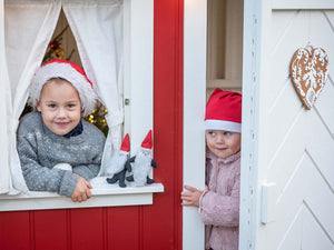 Kids waiting for Santa Claus inside Kids Playhouse Nordic Nario| red Outdoor Playhouse by WholeWoodPlayhouses