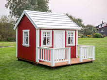 Load image into Gallery viewer, Red Outdoor Playhouse Nordic Nario with white roof, wooden terrace and white wooden fence on green lawn by WholeWoodPlayhouses