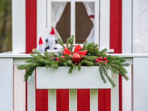 Close up of the wooden flower box with cristmas decoration of Kids Playhouse Nordic Nario by WholeWoodPlayhouses