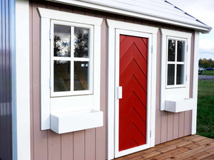 Close up of the front windows and door of Wooden Playhouse Plum by WholeWoodPlayhouses