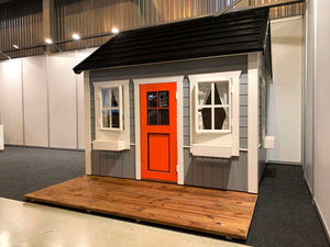 Front outside view of gray Outdoor Kids Playhouse Boy Cave by WholeWoodPlayhouses