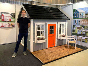 Wooden Playhouse Boy Cave with wooden terrace and black roof by WholeWoodPlayhouses