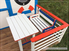 Load image into Gallery viewer, Kids furniture set of table and bench on boat themed kids playhouse Marine Max terrace by WholeWoodPlayhouses