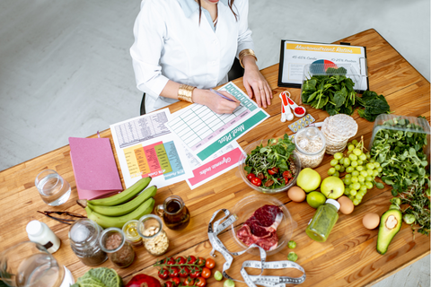 person sitting with notebook planning meals