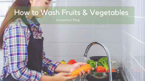 lady washing vegetables in sink