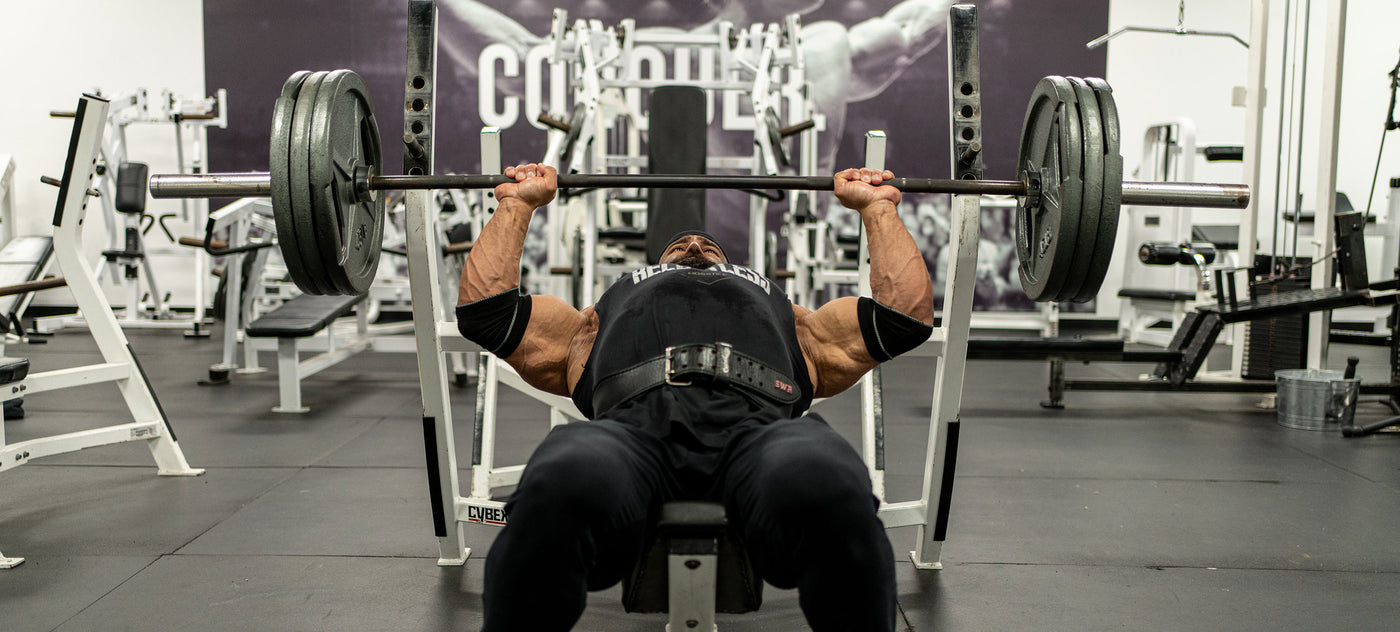 Bodybuilder Fouad Abiad bench pressing in the gym