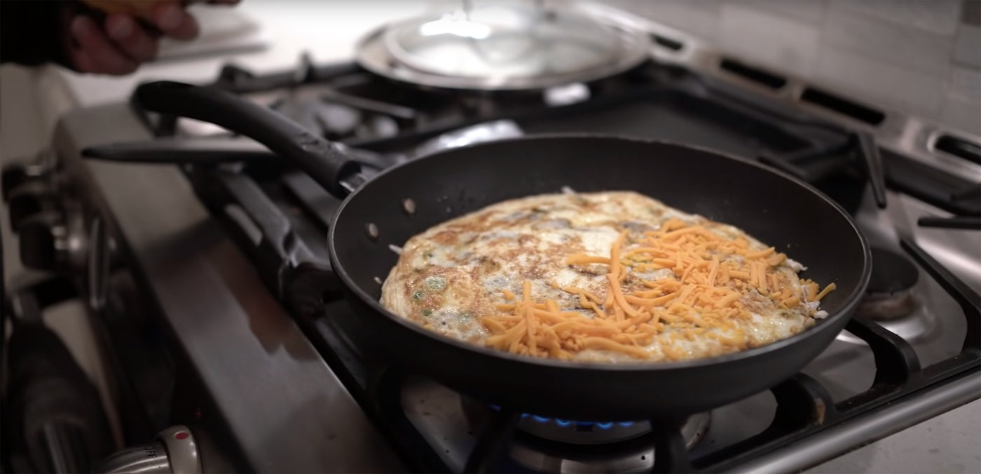 Fouad Abiad Cooking Egg White Omelet with Vegetables and Cheese
